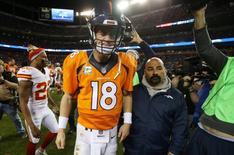 Denver Broncos quarterback Peyton Manning (18) leaves the field after the game against the Kansas City Chiefs at Sports Authority Field at Mile High. The Chiefs won 29-13. Mandatory Credit: Chris Humphreys-USA TODAY Sports