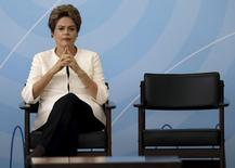 Brazil's President Dilma Rousseff looks on during a ceremony to announce the adaptation criteria in the AM and FM broadcasting grants, at the Planalto Palace in Brasilia, Brazil, November 24, 2015. REUTERS/Ueslei Marcelino