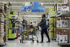 A customer pushes her shopping cart through the aisles at a Walmart store in the Porter Ranch section of Los Angeles November 26, 2013.  REUTERS/Kevork Djansezian