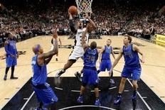 San Antonio Spurs power forward David West (30) puts up a shot over Dallas Mavericks point guard Devin Harris (34) during the second half at AT&T Center. Soobum Im-USA TODAY Sports
