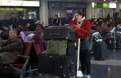 Aéroport international de Pékin. L'Association internationale du transport aérien (IATA) a revu en baisse sa prévision à long terme de croissance du nombre de passagers transportés dans le monde en expliquant s'attendre à une évolution moins favorable du contexte économique, notamment en Chine. /Photo prise le 23 novembre 2015/REUTERS/China Daily