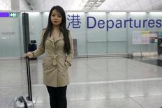 Miss World Canada Anastasia Lin poses for photo at the departure hall of Hong Kong Airport in Hong Kong, China November 26, 2015. REUTERS/Tyrone Siu