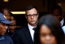 Paralympic track star Oscar Pistorius (C) leaves after listening to the closing arguments in his murder trial at the high court in Pretoria August 7, 2014. REUTERS/Siphiwe Sibeko