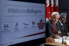 Canada's Immigration Minister John McCallum (L) and Defence Minister Harjit Sajjan attend a news conference in Ottawa, Canada November 24, 2015. REUTERS/Chris Wattie