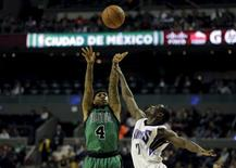 Isaiah Thomas (4) of Boston Celtics jumps for the ball with Darren Collison (7) of Sacramento Kings during their NBA Global Games basketball game in Mexico City, Mexico December 3, 2015. REUTERS/Henry Romero