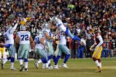 Dallas Cowboys tight end Jason Witten (82) picks up  kicker Dan Bailey (5) after his game winning field goal  during the fourth quarter against the Washington Redskins  at FedEx Field. Dallas Cowboys defeated Washington Redskins 19-16. Mandatory Credit: Tommy Gilligan-USA TODAY Sports