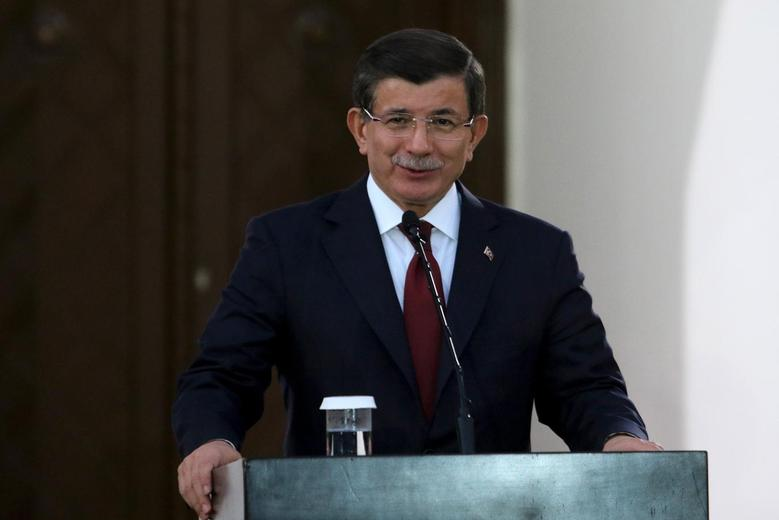 Turkish Prime Minister Ahmet Davutoglu  speaks to the media during a visit to northern Cyprus, December 1, 2015. REUTERS/Yiannis Kourtoglou