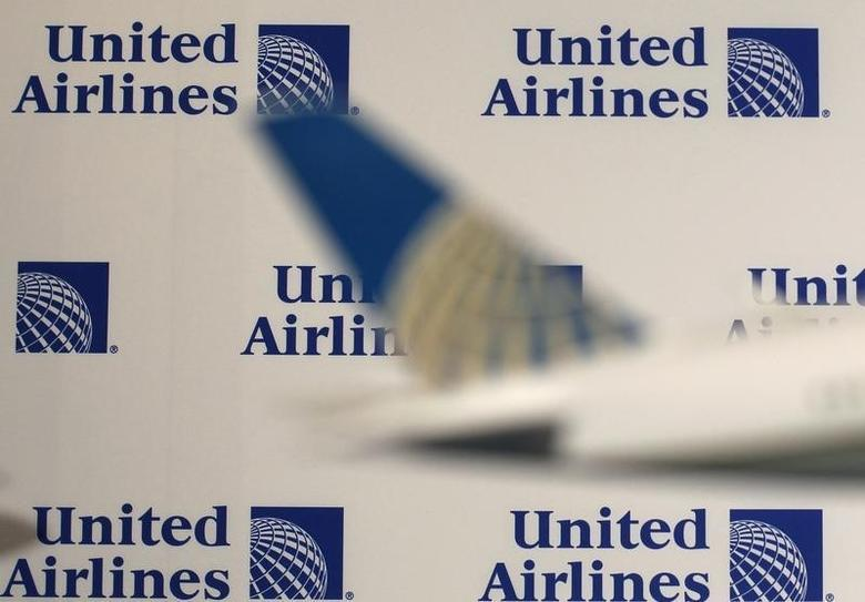 Logos are pictured on a wall before a news conference announcing the merger between Continental Airlines and United Airlines in New York, May 3, 2010.  REUTERS/Shannon Stapleton