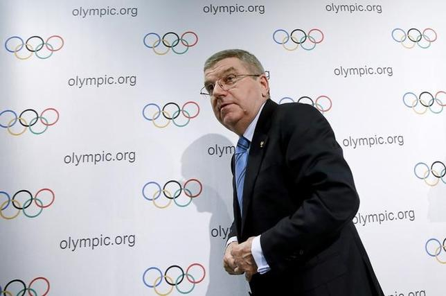 International Olympic Committee (IOC) President Thomas Bach leaves after a news conference in Lausanne, Switzerland, December 10, 2015. REUTERS/Denis Balibouse
