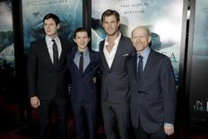 """Cast members Benjamin Walker, Tom Holland and Chris Hemsworth and director Ron Howard attend the premiere of """"In the Heart of the Sea"""" in the Manhattan borough of New York City, December 7, 2015. REUTERS/Andrew Kelly"""