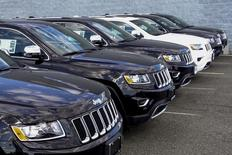 2015 Jeep Grand Cherokee are exhibited on a car dealership in New Jersey, July 24, 2015. Fiat Chrysler will recall 1.4 million vehicles in the United States to install software to prevent hackers from gaining remote control of the engine, steering and other systems in what federal officials said was the first such action of its kind. The recalled vehicles include some of the top-selling FCA products including the Jeep Grand Cherokee and Cherokee SUVs from model years 2014 and 2015 and 2015 Dodge Challenger sports coupes, among others. REUTERS/Eduardo Munoz