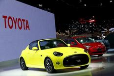 Toyota Motor Corp's S-FR concept car (L) and its new Prius hybrid car (2nd L) are on display at the 44th Tokyo Motor Show in Tokyo, Japan, October 28, 2015.   REUTERS/Thomas Peter