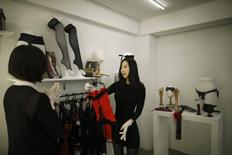 Kwak Eura (R) and Choi Jung-yoon arrange products at their sex toy shop in Seoul, South Korea, December 16, 2015.  REUTERS/Kim Hong-Ji