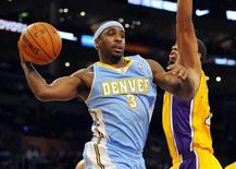 Denver Nuggets guard Ty Lawson (3) passes the ball from under the basket during the second half against the Los Angeles Lakers at Staples Center. Christopher Hanewinckel-USA TODAY Sports
