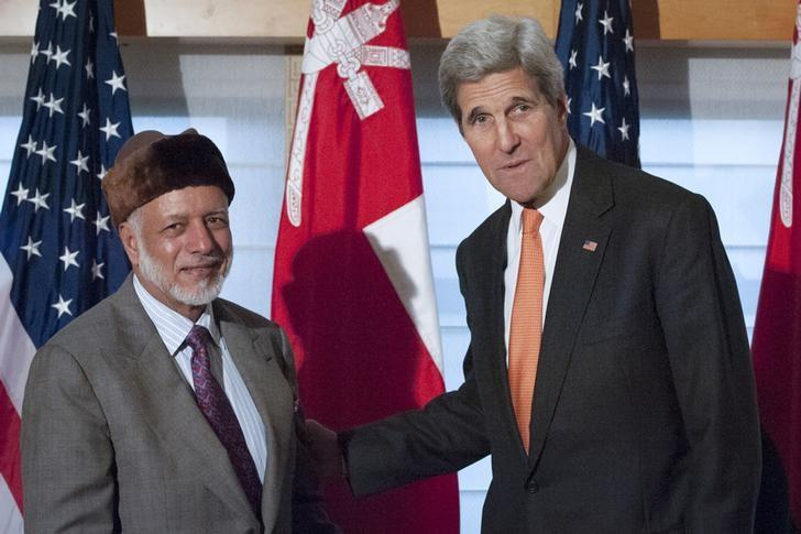United States Secretary of State John Kerry (R) shakes hands with Foreign Minister Yusuf bin Alawi bin Abdullah of Oman as they pose for photos at the Palace Hotel in New York, October 2, 2015. REUTERS/Stephanie Keith