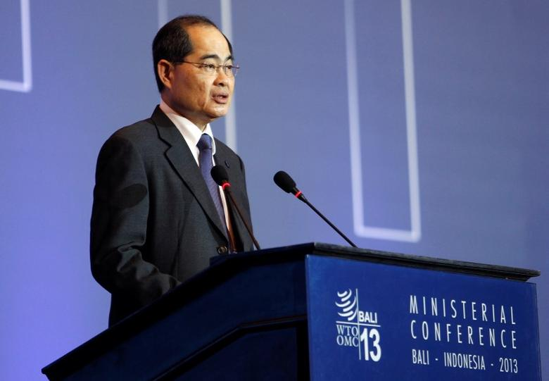 Singapore's trade minister Lim Hng Kiang speaks during a plenary session of the ninth World Trade Organization (WTO) Ministerial Conference in Nusa Dua, on the Indonesian resort island of Bali December 4, 2013.  REUTERS/Edgar Su