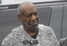Actor and comedian Bill Cosby (C) arrives for his arraignment on sexual assault charges at the Montgomery County Courthouse in Elkins Park, Pennsylvania December 30, 2015.  Cosby was charged on Wednesday with sexually assaulting a woman in 2004 after plying her with drugs and alcohol, marking the first criminal case against a once-beloved performer whose father-figure persona was already left tattered by dozens of misconduct allegations.    REUTERS/Mark Makela