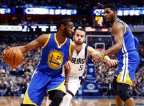 Golden State Warriors guard Ian Clark (21) drives to the basket past Dallas Mavericks guard J.J. Barea (5) during the second half at American Airlines Center. Dallas won 114 to 91. Mandatory Credit: Kevin Jairaj-USA TODAY Sports