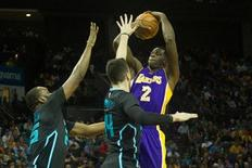 Los Angeles Lakers forward Brandon Bass (2) shoots the ball over Charlotte Hornets center Al Jefferson (25) during the first half at Time Warner Cable Arena. Mandatory Credit: Jeremy Brevard-USA TODAY Sports