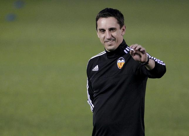 Valencia's new coach Gary Neville greets the public during his first training session in Valencia, Spain, December 7, 2015. REUTERS/Heino Kalis
