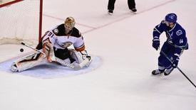 Jan 1, 2016; Vancouver, British Columbia, CAN; Vancouver Canucks forward Alexandre Burrows (14) scores against Anaheim Ducks goaltender Frederik Andersen (31) during the overtime shootout at Rogers Arena. The Vancouver Canucks won 2-1 in a shoot out. Mandatory Credit: Anne-Marie Sorvin-USA TODAY Sports