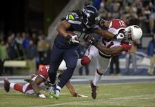 Nov 15, 2015; Seattle, WA, USA; Seattle Seahawks running back Marshawn Lynch (24) is defended by Arizona Cardinals cornerback Patrick Peterson (21) during a NFL football game at CenturyLink Field. Mandatory Credit: Kirby Lee-USA TODAY Sports
