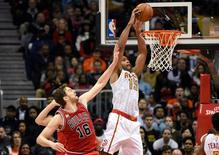 Jan 9, 2016; Atlanta, GA, USA; Atlanta Hawks center Al Horford (15) scores off a pass over Chicago Bulls center Pau Gasol (16) during the second half at Philips Arena. The Hawks defeated the Bulls 120-105. Mandatory Credit: Dale Zanine-USA TODAY Sports