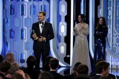 """Leonardo DiCaprio holds his award for Best Actor, Motion Picture, Drama, for """"The Revenant"""", at the 73rd Golden Globe Awards in Beverly Hills, California January 10, 2016.  REUTERS/Paul Drinkwater/NBC Universal/Handout For editorial use only."""