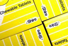 Витамины производства Shire в лондонской аптеке. 11 июля 2014 года. Фармацевтическая компания Shire договорилась о покупке американской Baxalta International за $32 миллиарда в денежных средствах и акциях, что приведёт к созданию лидирующей мировой корпорации, занимающейся производством лекарств от редких заболеваний. REUTERS/Suzanne Plunkett