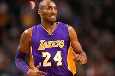 Los Angeles Lakers forward Kobe Bryant (24) reacts during the second half of a game against the Boston Celtics at TD Garden. Mark L. Baer-USA TODAY Sports
