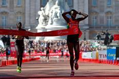 Edna Kiplagat of Kenya crosses the finish line followed by compatriot Florence Kiplagat to win the women's Elite London Marathon April 13, 2014.      REUTERS/Eddie Keogh