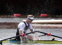 New Zealand's Mahe Drysdale celebrates winning gold in the men's rowing single sculls final during the London 2012 Olympic Games at Eton Dorney in this file photo dated August 3, 2012. REUTERS/Jim Young
