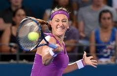 Victoria Azarenka of Belarus returns the ball to Angelique Kerber of Germany during the women's singles final at the Brisbane International Tennis Tournament in Brisbane, Australia, January 9, 2016.    REUTERS/Dave Hunt/AAP