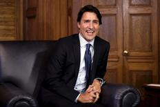 Canada's Prime Minister Justin Trudeau laughs during a meeting with Nova Scotia Premier Stephen McNeil (not pictured) in Trudeau's office on Parliament Hill in Ottawa, Canada, January 13, 2016. REUTERS/Chris Wattie