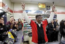 7-Eleven store clerk M. Faroqui celebrates after selling a winning Powerball ticket was sold is shown in Chino Hills, California January 13, 2016. REUTERS/Alex Gallardo