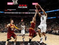 Jan 14, 2016; San Antonio, TX, USA; San Antonio Spurs point guard Tony Parker (9) drives to the basket as Cleveland Cavaliers point guard Matthew Dellavedova (8, left) defends during the first half at AT&T Center.  Soobum Im-USA TODAY Sports