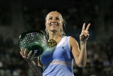 Svetlana Kuznetsova of Russia poses with her trophy after winning the Sydney International tennis women's singles title in Sydney, Australia January 15, 2016. Kuznetsova defeated Monica Puig of Puerto Rico to win the Australian tournament. REUTERS/Jason Reed