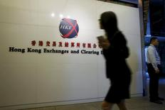 A staffer walks into the Hong Kong Stock Exchange in Hong Kong in this October 28, 2014 file photo. REUTERS/Bobby Yip/Files