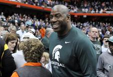 Mar 27, 2015; Syracuse, NY, USA; Michigan State Spartans former player Magic Johnson during the second half against the Oklahoma Sooners in the semifinals of the east regional of the 2015 NCAA Tournament at Carrier Dome. Mandatory Credit: Mark Konezny-USA TODAY Sports