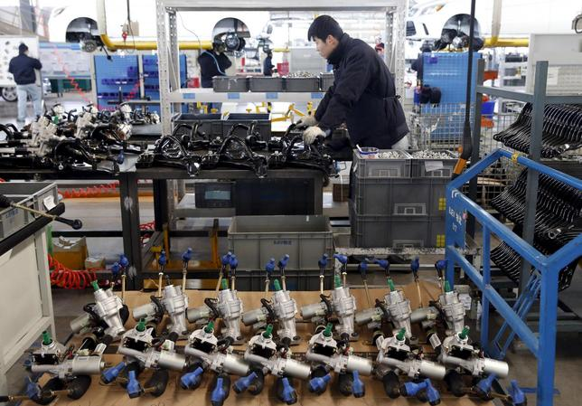 An employee works on an assembly line producing electronic cars at a factory of Beijing Electric Vehicle, funded by BAIC Group, in Beijing, China, January 18, 2016.  REUTERS/Kim Kyung-Hoon