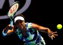 Venus Williams of the U.S. hits a shot during her first round match against Britain's Johanna Konta at the Australian Open tennis tournament at Melbourne Park, Australia, January 19, 2016. REUTERS/Thomas Peter