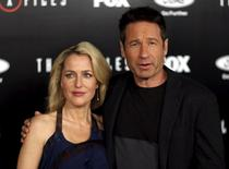 """Cast members Gillian Anderson and David Duchovny pose at a premiere for """"The X-Files"""" at California Science Center in Los Angeles, California January 12, 2016. A 6-episode series premieres on January 24.  REUTERS/Mario Anzuoni - RTX225GW"""