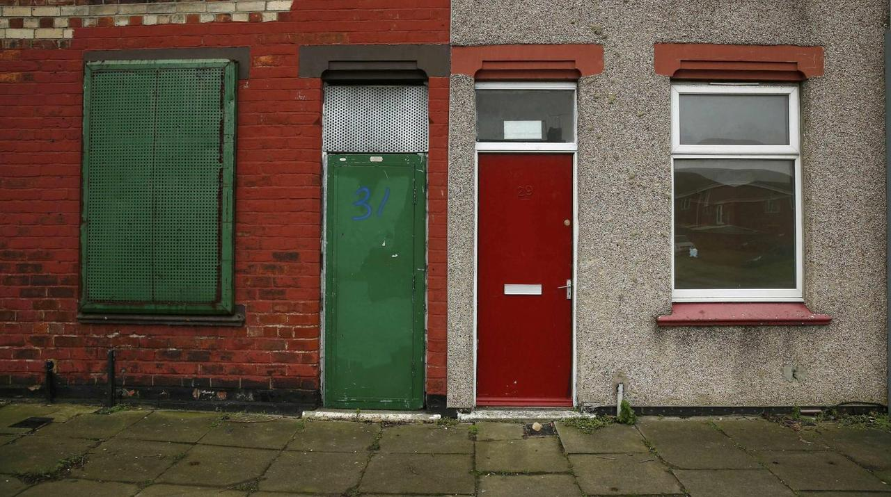 Red Doors Mark Out Asylum Seekers Houses In English Town