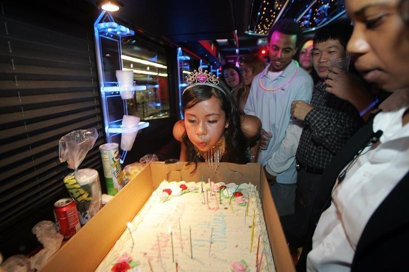 Christine Tran Blows Out The Candles On Her Cake While Celebrating Birthday A Party Bus In New York This February 18 2006 File Photo