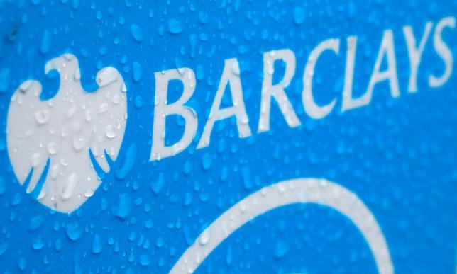 Raindrops are seen on the logo of a rental bicycle sponsored by Barclays in London May 8, 2014.  REUTERS/Stefan Wermuth