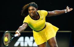 Serena Williams of the U.S. hits a shot during her third round match against Russia's Daria Kasatkina at the Australian Open tennis tournament at Melbourne Park, Australia, January 22, 2016. REUTERS/Thomas Peter