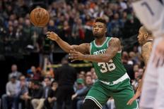 Jan 18, 2016; Dallas, TX, USA; Boston Celtics guard Marcus Smart (36) passes the ball during the game against the Dallas Mavericks at the American Airlines Center. The Celtics are among the teams whose matches have been postponed due to snow.  Mandatory Credit: Jerome Miron-USA TODAY Sports