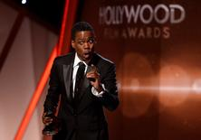 "Chris Rock accepts the Hollywood Comedy Film Award for ""Top Five"" during the Hollywood Film Awards in Hollywood, California November 14, 2014.   REUTERS/Kevork Djansezian"