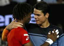 Canada's Milos Raonic (R) talks with France's Gael Monfils at the net after Raonic won their quarter-final match at the Australian Open tennis tournament at Melbourne Park, Australia, January 27, 2016. REUTERS/Tyrone Siu