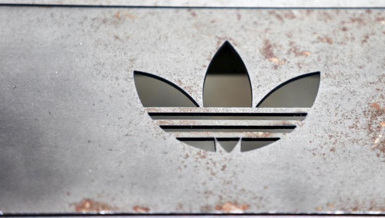 The Adidas logo on an iron bench is pictured at the flagship store in Berlin, Germany, January 20, 2016.    REUTERS/Hannibal Hanschke